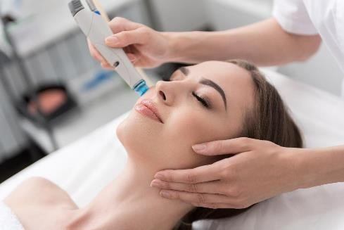Woman receiving a microdermabrasion