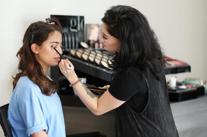 Makeup being applied to a woman's face.